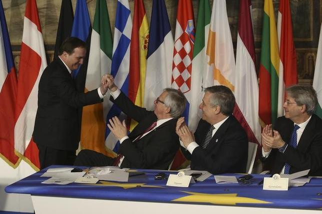 Sweden's Prime Minister Stefan Lofven is congratulated by European Commission President Jean-Claude Juncker after signing a document as European Parliament President Antonio Tajani (2nd R) and Italy's Prime Minister Paolo Gentiloni (R) during the EU leaders meeting on the 60th anniversary of the Treaty of Rome, in Rome, Italy March 25, 2017. REUTERS/Remo Casilli