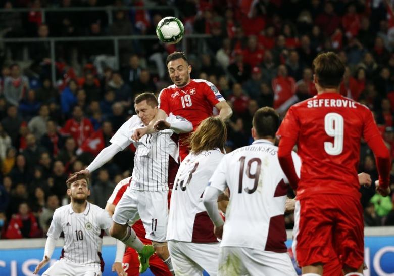 Soccer Football - Switzerland v Latvia - World Cup 2018 Qualifiers - Stade de Geneve, Geneva, Switzerland - 25/03/17 - Switzerland's Josip Drmic (C) scores against Latvia.   REUTERS/Denis Balibouse