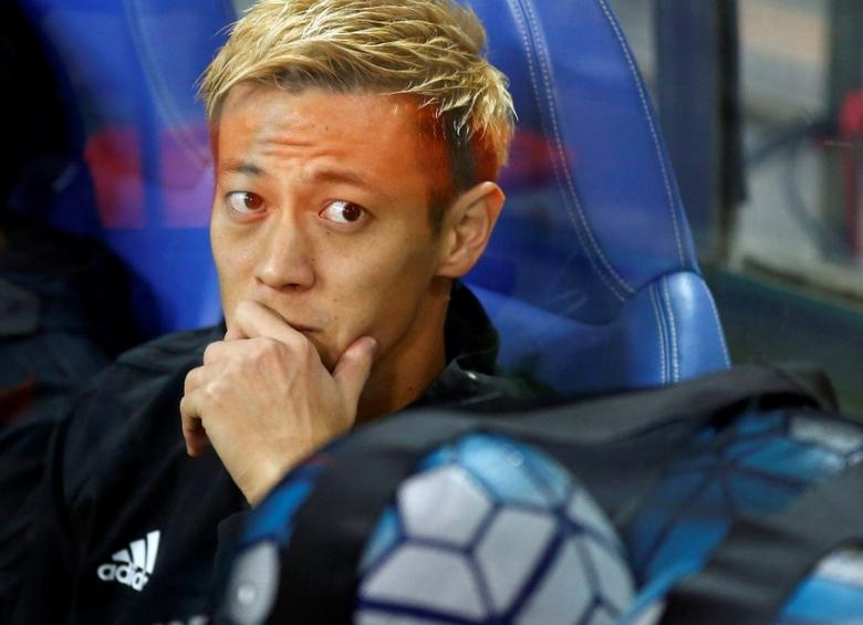 FILE PHOTO: Football Soccer - Japan v Saudi Arabia - World Cup 2018 Qualifier - Saitama Stadium 2002, Saitama, Japan - 15/11/16. Japan's Keisuke Honda is seen in the bench seat before the match. REUTERS/Toru Hanai