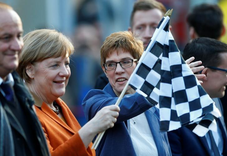 Annegret Kramp-Karrenbauer, State Minister-President and top candidate of the Christian Democratic Union Party (CDU) and German Chancellor Angela Merkel attend an election rally for the upcoming state elections in the Saarland, in St. Wendel near Saarbruecken, Germany March 23, 2017. REUTERS/Ralph Orlowski