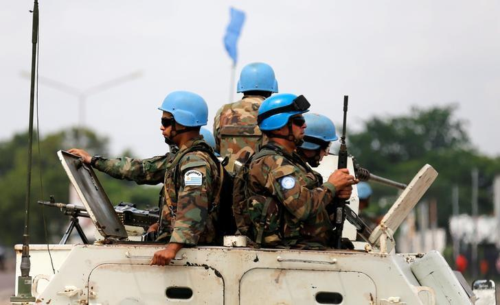 Peacekeepers serving in the United Nations Organization Stabilization Mission in the Democratic Republic of the Congo (MONUSCO) patrol in their armoured personnel carrier during demonstrations against Congolese President Joseph Kabila in the streets of the Democratic Republic of Congo's capital Kinshasa, December 20, 2016. REUTERS/Thomas Mukoya
