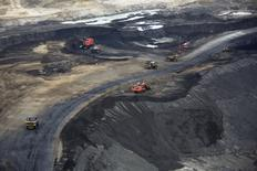 Heavy earth moving machinery move raw tars sands at the Syncrude tar sands mining operations near Fort McMurray, Alberta, September 17, 2014. REUTERS/Todd Korol