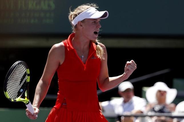3月27日、テニスのマイアミ・オープン女子シングルス4回戦、第12シードのキャロライン・ウォズニアッキは準々決勝に進出(2017年 ロイター/GeoffBurke-USA TODAY Sports)
