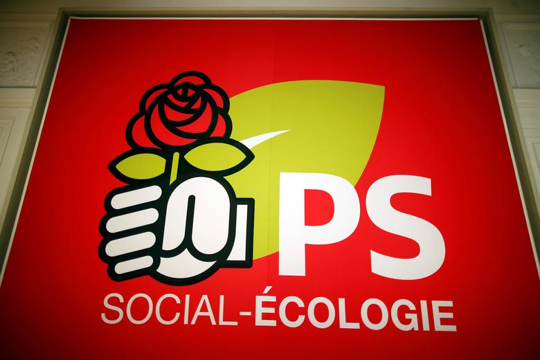 A poster of the French Socialist party which reads ''Social-Ecology'' is seen at the rue de Solferino headquarters in Paris, France, December 3, 2015. REUTERS/Charles Platiau/Files