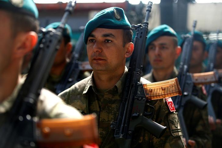 Turkish soliders attend a EUFOR Change of Command Ceremony in Sarajevo, Bosnia and Herzegovina March 28, 2017. REUTERS/Dado Ruvic