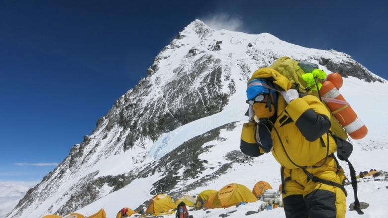A porter carries goods at camp four at Everest, in this picture taken on May 20, 2016. Phurba Tenjing Sherpa/Handout via REUTERS/File Photo