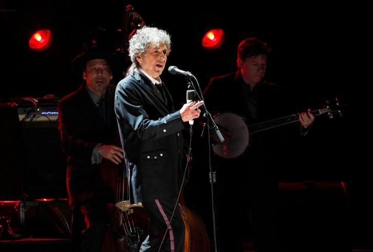 Bob Dylan performs during a segment honoring Director Martin Scorsese, recipient of the Music + Film Award, at the 17th Annual Critics' Choice Movie Awards in Los Angeles January 12, 2012. REUTERS/Mario Anzuoni/File Photo