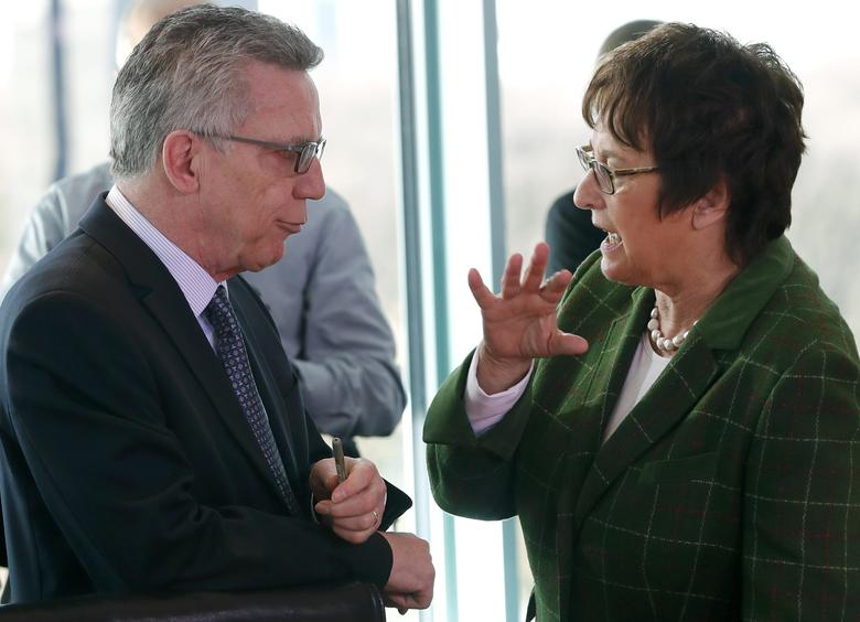 Economy Minister Brigitte Zypries talks to Interior Minister Thomas de Maiziere before a cabinet meeting in Berlin, Germany, March 22, 2017.     REUTERS/Fabrizio Bensch