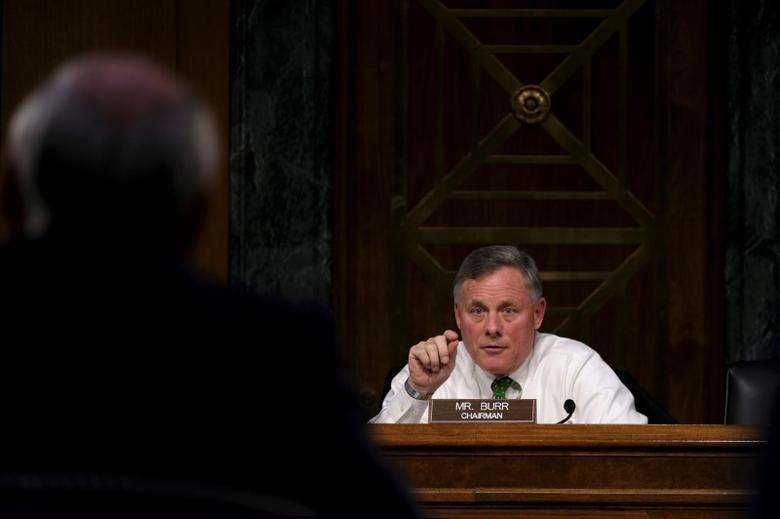 FILE PHOTO: Committee Chairman U.S. Senator Richard Burr (R-NC) questions former U.S. Senator Dan Coats (R-IN) as he testifies before the Senate Select Committee on Intelligence on his nomination to be Director of National Intelligence in Washington February 28, 2017. REUTERS/James Lawler Duggan
