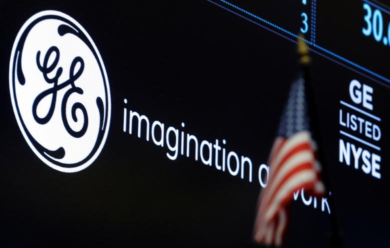 The ticker and logo for General Electric Co. is displayed on a screen at the post where it's traded on the floor of the New York Stock Exchange (NYSE) in New York City, U.S., June 30, 2016.  REUTERS/Brendan McDermid