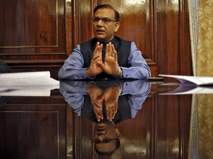 India's Junior Finance Minister Sinha gestures during an interview with...