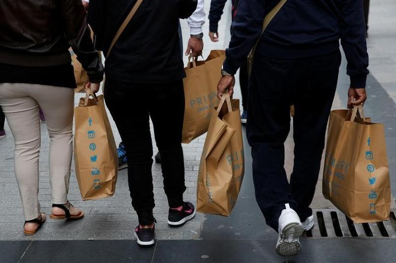 Shoppers carry Primark bags in a commercial district in downtown Madrid, Spain, May 11, 2016. REUTERS/Susana Vera