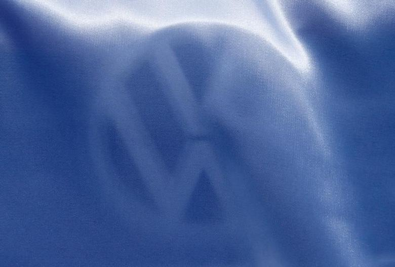 A Volkswagen logo is seen covered on the Volkswagen stand during the 87th International Motor Show at Palexpo in Geneva, Switzerland, March 7, 2017. REUTERS/Denis Balibouse
