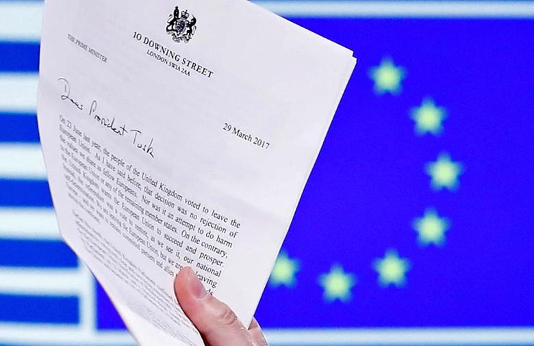 EU Council President Donald Tusk holds British Prime Minister Theresa May's Brexit letter, which was delivered by Britain's permanent representative to the European Union Tim Barrow (not pictured) that gives notice of the UK's intention to leave the bloc under Article 50 of the EU's Lisbon Treaty, in Brussels, Belgium, March 29, 2017. Picture taken March 29, 2017.  REUTERS/Yves Herman