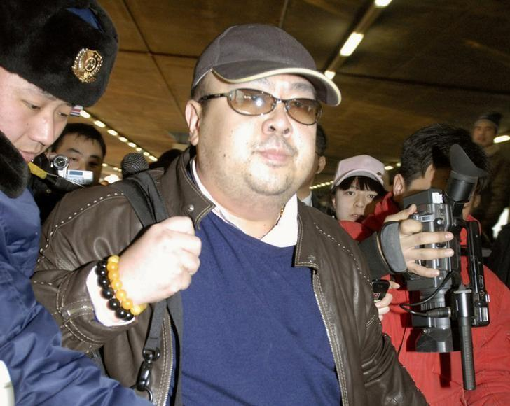 FILE PHOTO: Kim Jong Nam arrives at Beijing airport in Beijing, China, in this photo taken by Kyodo February 11, 2007.  Mandatory credit Kyodo/via REUTERS/File Photo