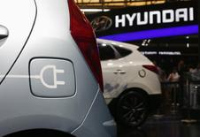 FILE PHOTO: A Hyundai electric car is seen during the 15th Shanghai International Automobile Industry Exhibition in Shanghai April 21, 2013.  REUTERS/Carlos Barria