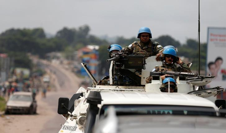 Peacekeepers serving in the United Nations Organization Stabilization Mission in the Democratic Republic of the Congo (MONUSCO) patrol in their armoured personnel carrier during demonstrations against Congolese President Joseph Kabila in the streets of the Democratic Republic of Congo's capital Kinshasa, December 20, 2016. REUTERS/Thomas Mukoya/Files