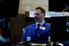 Wall Street a fini dans le vert jeudi. L'indice Dow Jones a gagné 0,33%. /Photo prise le 30 mars 2017/REUTERS/Brendan McDermid