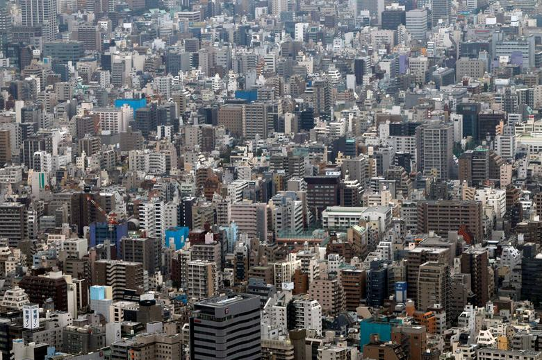 FILE PHOTO: Medium-rise and low-rise residences and office buildings are seen from the first observatory deck of Tokyo Sky Tree in Tokyo October 30, 2011.  REUTERS/Issei Kato/File Photo