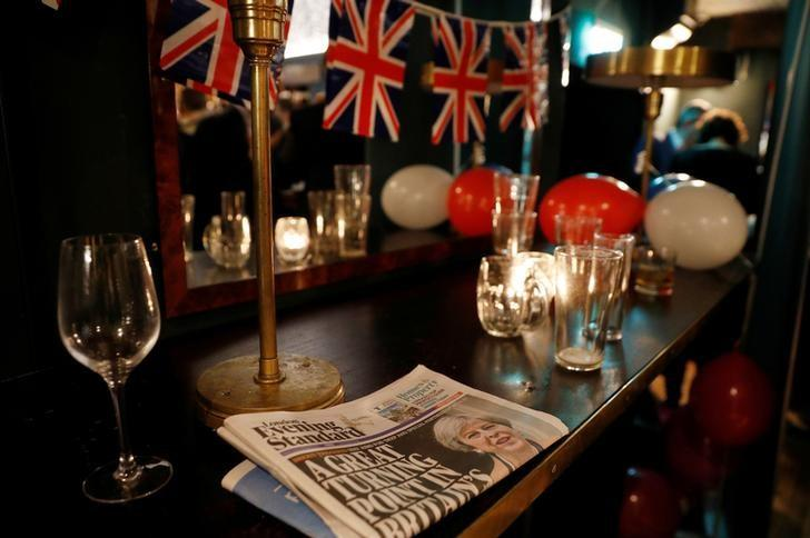 A newspaper is seen on a bar at a Pro-Brexit event to celebrate the invoking of Article 50 after Britain's Prime Minister Theresa May triggered the process by which the United Kingdom will leave the European Union, in London, Britain March 29, 2017. REUTERS/Peter Nicholls