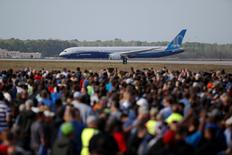 Employees and guest watch during the first flight ceremony of the new Boeing 787-10 Dreamliner at the Charleston International Airport in North Charleston, South Carolina, United States March 31, 2017.  REUTERS/Randall Hill