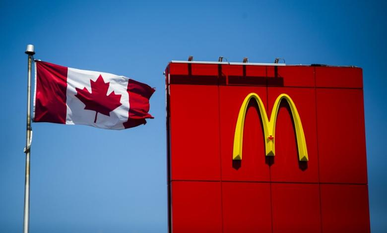 A Canadian flag waves beside McDonalds fast food restaurant in Toronto, May 1, 2014.  REUTERS/Mark Blinch