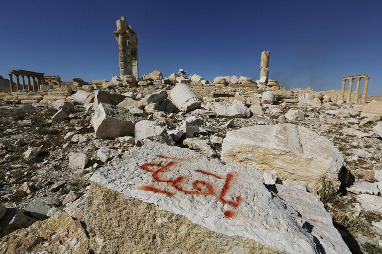 FILE PHOTO: Graffiti sprayed by Islamic State militants which reads ''We remain'' is seen on a stone at the Temple of Bel in the historic city of Palmyra, in Homs Governorate, Syria April 1, 2016. REUTERS/Omar Sanadik/File Photo