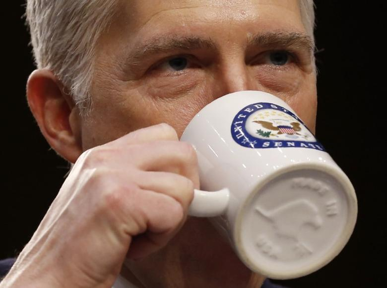 U.S. Supreme Court nominee judge Neil Gorsuch takes a drink while testifying during the third day of his Senate Judiciary Committee confirmation hearing on Capitol Hill in Washington, U.S., March 22, 2017. REUTERS/Jonathan Ernst