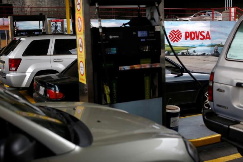 The corporate logo of the state oil company PDVSA is seen in a gas station in Caracas, Venezuela March 23, 2017. REUTERS/Carlos Garcia Rawlins/Files