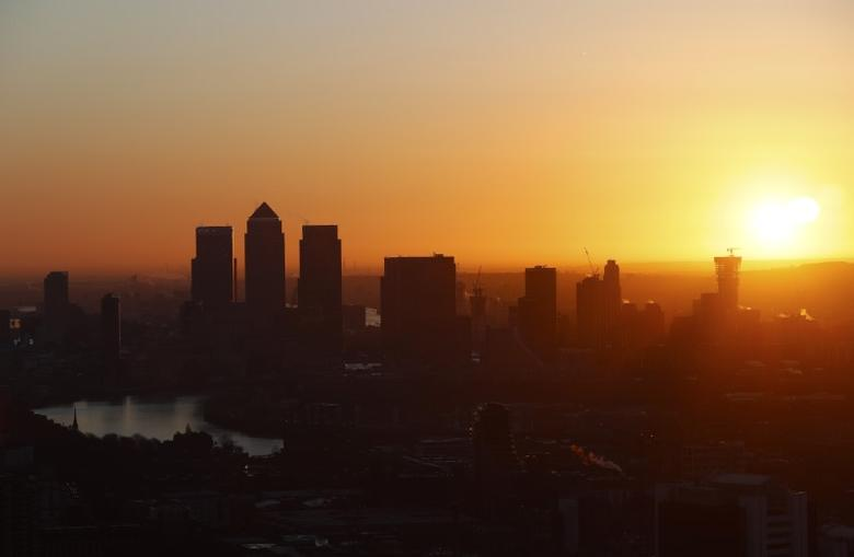 Canary Wharf is seen at sunrise from the Sky Garden of 20 Fenchurch Street, nicknamed the Walkie-Talkie building, in the financial district of the City of London, February 19, 2016.        REUTERS/Eddie Keogh