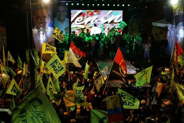 Ecuadorean presidential candidate Lenin Moreno (C on stage) and supporters celebrate in a hotel in Quito, Ecuador, April 2, 2017.  REUTERS/Mariana Bazo