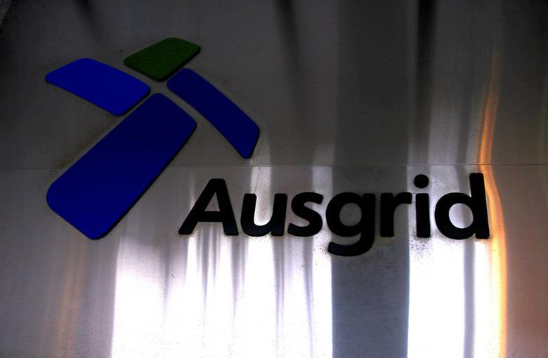 FILE PHOTO: The logo for Australia's biggest electricity network Ausgrid adorns the main entrance to the headquarters building in central Sydney, Australia, July 25, 2016. REUTERS/David Gray/File Photo