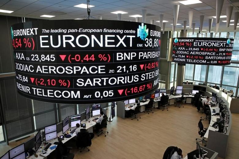 Company stock price information is displayed on screens as they hang above the Paris stock exchange, operated by Euronext NV, in La Defense business district in Paris, France, December 14, 2016. REUTERS/Benoit Tessier