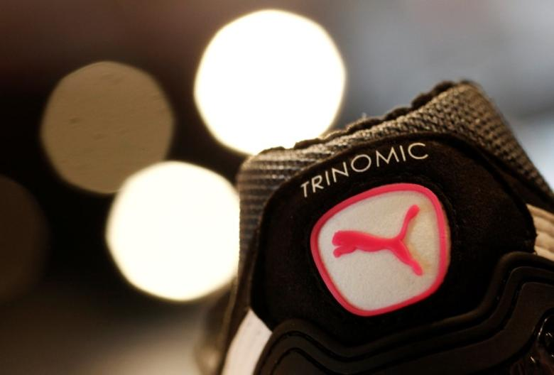 FILE PHOTO -  The logo of German sports goods firm Puma is seen on a shoe after the company's annual news conference in Herzogenaurach February 20, 2014.      REUTERS/Michaela Rehle/File Photo