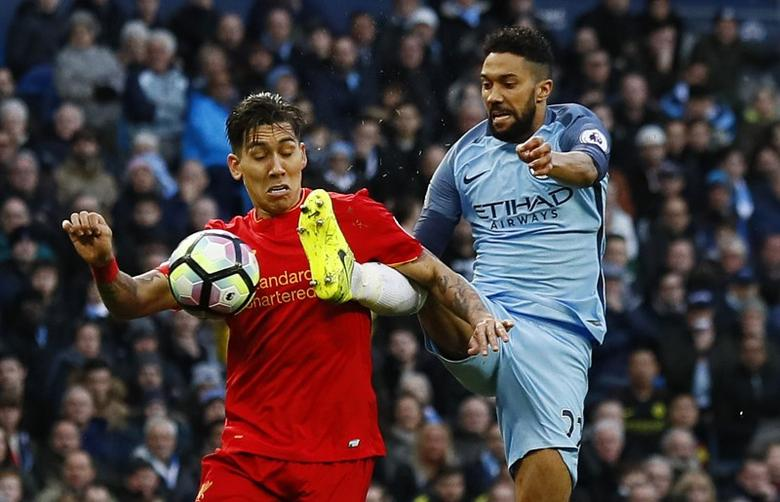 Britain Soccer Football - Manchester City v Liverpool - Premier League - Etihad Stadium - 19/3/17 Manchester City's Gael Clichy fouls Liverpool's Roberto Firmino for a penalty Action Images via Reuters / Jason Cairnduff Livepic