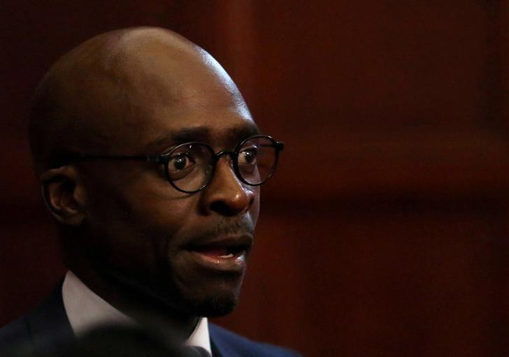 FILE PHOTO: South Africa's new finance minister, Malusi Gigaba looks on after the swearing in of cabinet ministers following a reshuffle that replaced Pravin Gordhan as finance minister with Gigaba along with various other ministers and their deputies in Pretoria, South Africa, March 31,2017. REUTERS/Siphiwe Sibeko/File Photo