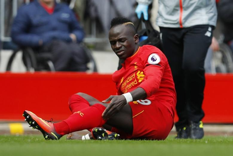 Britain Soccer Football - Liverpool v Everton - Premier League - Anfield - 1/4/17 Liverpool's Sadio Mane after sustaining an injury  Reuters / Phil Noble Livepic