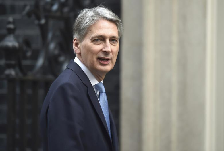 Britain's Chancellor of the Exchequer Philip Hammond arrives in Downing Street, London March 29, 2017. REUTERS/Hannah McKay