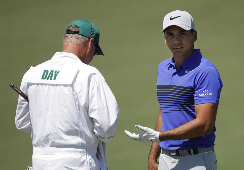 Jason Day of Australia talks with his caddie Colin Swatton on the second hole during Tuesday  practice rounds for the 2017 Masters at Augusta National Golf Club in Augusta, Georgia, U.S., April 4, 2017. REUTERS/Lucy Nicholson