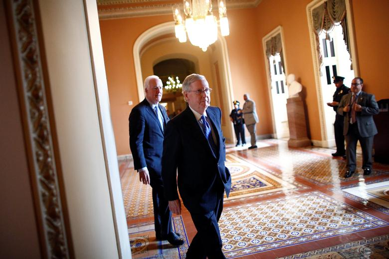 U.S. Senate Majority Leader Mitch McConnell (R-KY) walks to speak to reporters after the weekly Republican caucus policy luncheon at the U.S. Capitol in Washington, U.S. April 4, 2017. REUTERS/Eric Thayer