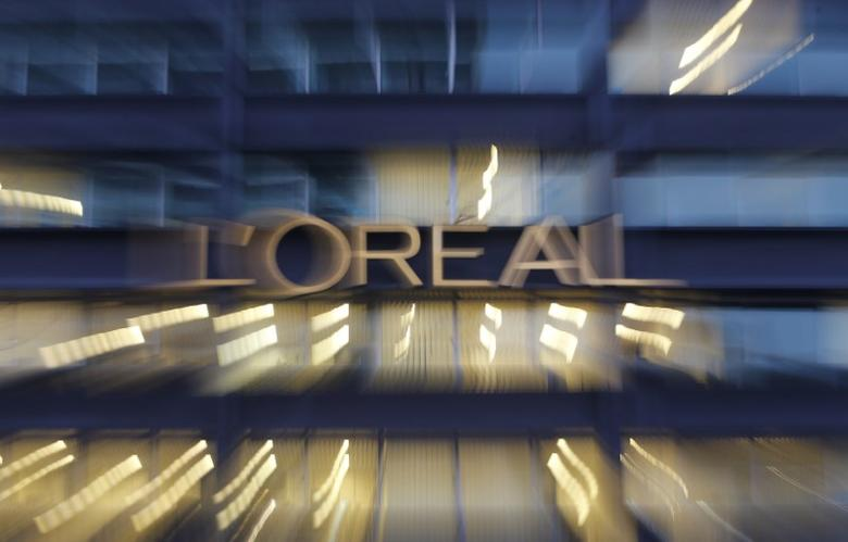 The logo of French cosmetics group L'Oreal is seen on the company's building in Clichy, near Paris February 12, 2015. REUTERS/Christian Hartmann