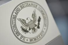 FILE PHOTO: The U.S. Securities and Exchange Commission logo adorns an office door at the SEC headquarters in Washington, June 24, 2011.  REUTERS/Jonathan Ernst