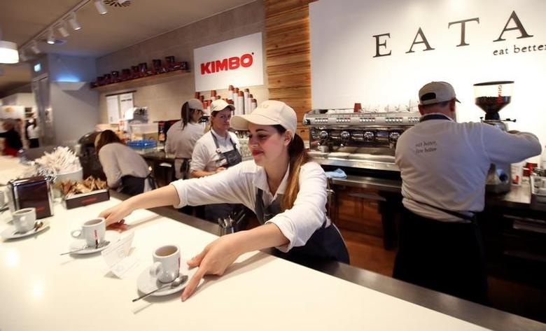 A barman serves Kimbo espresso coffees at the Eataly motorway restaurant on highway in Modena, Central Italy, May 30, 2016.  REUTERS/Stefano Rellandini