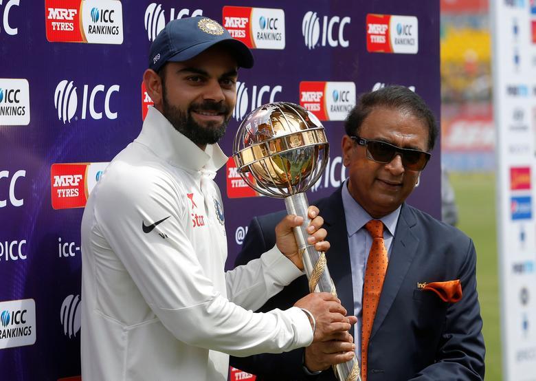Cricket - India v Australia - Fourth Test cricket match - Himachal Pradesh Cricket Association Stadium, Dharamsala - 28/03/17 - India's Virat Kohli receives the ICC Test Mace from former Indian cricket player Sunil Gavaskar (R) after India won the test series against Australia. REUTERS/Adnan Abidi