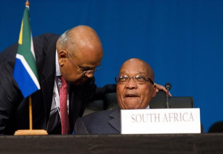 Pravin Gordhan speaks to President Jacob Zuma (R) during closing remarks during the 5th BRICS Summit in Durban, March 27, 2013. REUTERS/Rogan Ward/Files