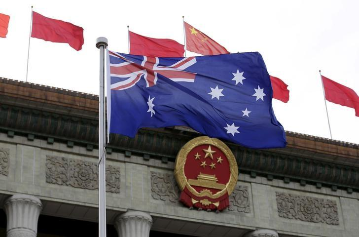 Australian flag flutters in front of the Great Hall of the People during a welcoming ceremony for Australian Prime Minister Malcolm Turnbull (not in picture) in Beijing, China, April 14, 2016. REUTERS/Jason Lee/Files