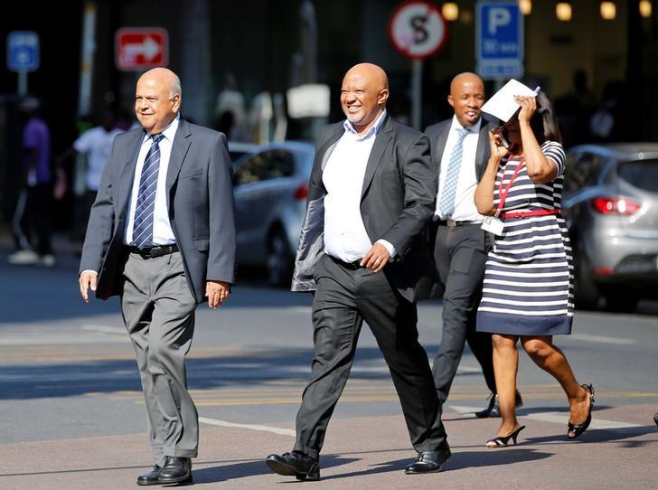 South Africa's Finance Minister Pravin Gordhan (L) walks with his deputy, Mcebisi Jonas as they walk from their offices to a court hearing in Pretoria, South Africa, March 28,2017. REUTERS/Siphiwe Sibeko/Files