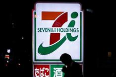 A pedestrian walks in front of a signage of Seven & I Holdings' 7-Eleven convenience store in Tokyo, Japan, in this April 7, 2016 file photo. REUTERS/Yuya Shino/Files