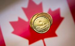 "File Photo: A Canadian dollar coin, commonly known as the ""Loonie"", is pictured in this illustration picture taken in Toronto January 23, 2015.   REUTERS/Mark Blinch/File Photo"