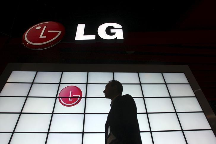 FILE PHOTO -  A show attendee passes by the LG Electronics booth during the 2009 International Consumer Electronics Show (CES) in Las Vegas, Nevada, in this file picture taken January 9, 2009.   REUTERS/Steve Marcus/File Photo